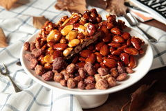 Sweet crunchy almonds and hazelnuts Stock Photos