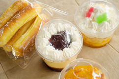 Sweet cup cake and bakery. Cupcakes in a plastic cup and sweet bread Stock Photos