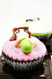 Sweet cup cake with a funny figure. Sweet cup cake decorated with a funny figure Royalty Free Stock Images