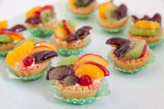 Sweet cup cakes with fruits Stock Photos
