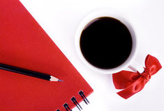 Sweet cup and red pad on white table Royalty Free Stock Image
