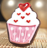 Sweet cupcake cookie. And balloons Royalty Free Stock Images