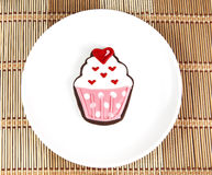 Sweet cupcake cookie. On white dish Royalty Free Stock Photo