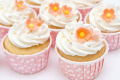 Sweet cupcakes and whipped cream in pink cup Royalty Free Stock Photography