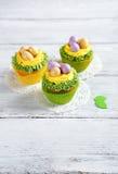 Sweet cupcakes on a white napkin Stock Photos