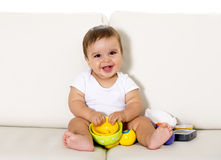 Free Sweet Cute Little Baby Sitting On Couch Alone At Home Playing With Toys Happy And Relaxed Having Fun Stock Images - 50157434