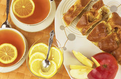 Sweet cuts of apple pie  with  lemon tea Stock Images