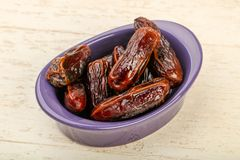 Sweet dates. Fruit heap in the bowl stock photos