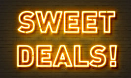 Sweet deals neon sign. On brick wall background Royalty Free Stock Photography
