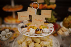 Sweet delicious cakes on plate at wedding reception. Royalty Free Stock Image