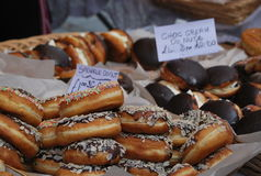 Sweet and delicious donuts in the market in Nottinghill, in London. Sweet and delicious donuts on the stand in the open air market in Nottinghill, one of the stock image