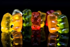 Sweet, delicious gummy bears in small groups, dancing, talking party conceptual image stock image