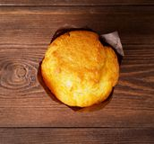 Sweet delicious muffin, on brown wooden background, top view. Sweet delicious muffin, on the brown wooden background, top view Royalty Free Stock Images