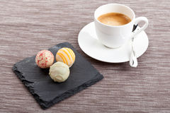 Sweet delicious truffle pralines chocolate and hot espresso coffee Royalty Free Stock Image