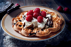 Sweet and delicious waffles with fruits Stock Photography