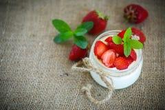 Sweet delicious  yogurt with fresh strawberries Stock Photography