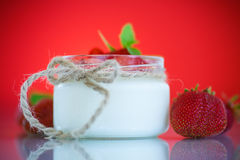 Sweet delicious  yogurt with fresh strawberries Stock Images