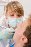 At the sweet dentist. Young man at the sweet dentist Stock Photo