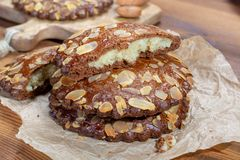 Sweet dessert for autumn season, Dutch filled cookies with marzipan and almonds stock photos