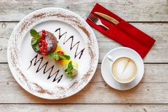 Sweet dessert with coffee on the wooden table Stock Images