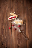 Sweet dessert with fresh raspberries on wood table. Sweet dessert with fresh raspberries on old wood table Royalty Free Stock Photography