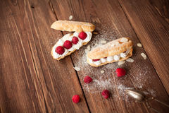 Sweet dessert with fresh raspberries on wood table Royalty Free Stock Photos