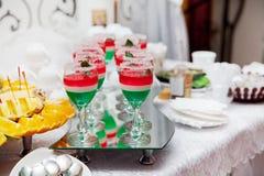 Sweet dessert - fruit jelly. Multicolored jelly cups, sweet dessert stock photo