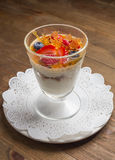 Sweet dessert in glass with biscuit,berry fruit Stock Images