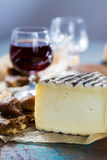 Sweet dessert liqueur wine in glass, hard french cheese Tomme de stock photo
