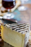 Sweet dessert liqueur wine in glass, hard french cheese Tomme de stock photos