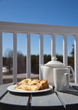 Sweet dessert on a patio. Slice of Panettone with a cup of tea served outdoors Royalty Free Stock Photo