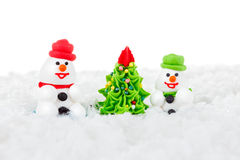 Sweet dessert snowman, snow and Christmas tree with festive decoration Royalty Free Stock Image