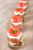 Sweet dessert tiramisu with fresh grapefruit Stock Images