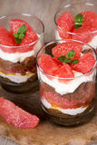 Sweet dessert tiramisu with fresh grapefruit Royalty Free Stock Photo