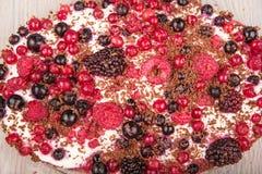 Sweet dessert tiramisu with strawberries, raspberries and bluebe Stock Photo