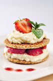 Sweet dessert - wafers with vanilla creme and strawberries Royalty Free Stock Photos
