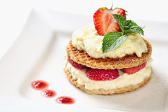 Sweet dessert - wafers with vanilla creme and strawberries Stock Photos