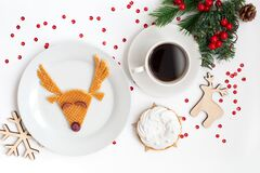 Christmas dish featuring a deer with cup coffe. View from above.