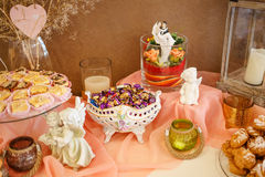 Sweet desserts with cream, berries and pastry on banquet table. Royalty Free Stock Photos