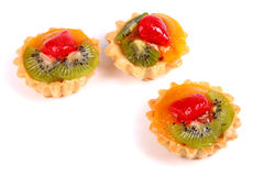 Sweet desserts with a kiwi, orange fruit and strawberry Stock Images