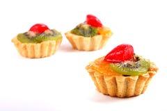 Sweet desserts with a kiwi, orange fruit and strawberry Royalty Free Stock Image