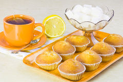 Sweet  domestic cakes, tea, lemon and vase with sugar Royalty Free Stock Images