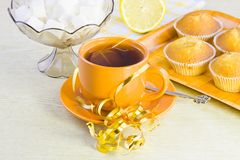 Sweet  domestic cakes, tea, lemon and vase with sugar Stock Image