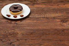 Sweet donut. Amazing chocolate covered donut with icing Stock Photos