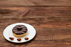 Sweet donut. Amazing chocolate covered donut with icing Royalty Free Stock Photos