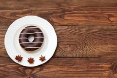 Sweet donut. Amazing chocolate covered donut with icing Royalty Free Stock Images