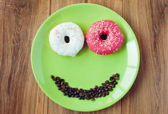 Sweet donut for a morning breakfast. Smile for sweet morning breakfast stock image