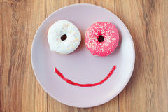 Sweet donut for a morning breakfast. Smile for sweet morning breakfast royalty free stock photo