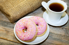 Sweet donut with pink frosting and sprinkles Stock Photos