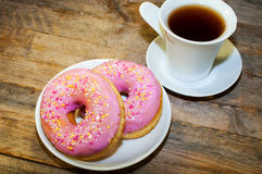 Sweet donut with pink frosting and sprinkles Stock Photo